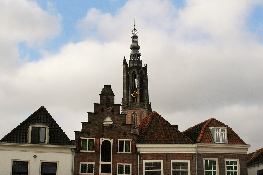 Church tower and medieval houses in Holland