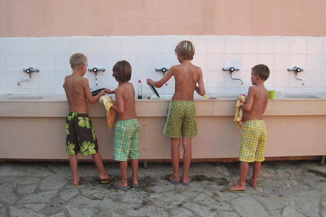 Boys doing dishes in summer