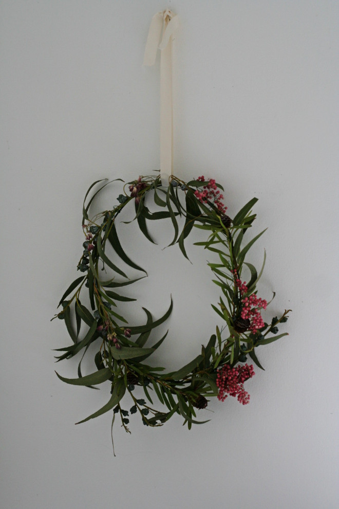 Wreath made from eucalyptus, pink pepper berries and Astrantia