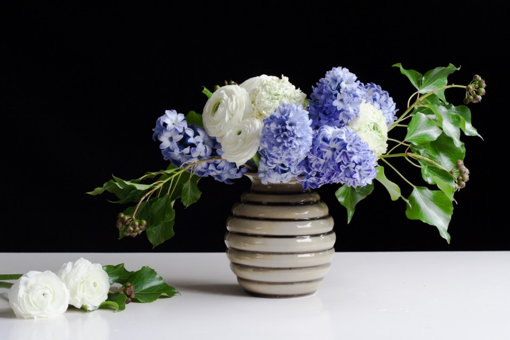 Flower arrangement with purple hyacinth and white ranunculus